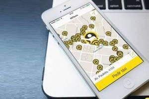 Smartphone com tela do app 99Taxis
