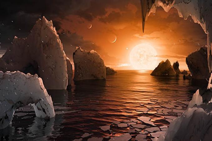 Ilustração de como pode ser um dos planetas recém-descobertos pela Nasa orbitando a estrela Trappist-1