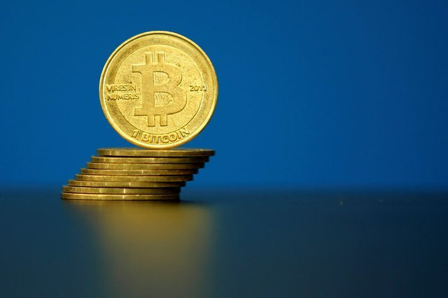 FILE PHOTO:An illustration photo of Bitcoin (virtual currency) coins are seen at La Maison du Bitcoin in Paris
