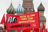 Russian Communist Party supporters carry flags at the Red Square with St. Basil's Cathedra seen in the background in Moscow