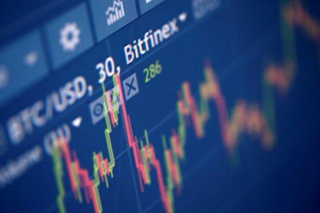 Photo illustration of Bitfinex cryptocurrency exchange website
