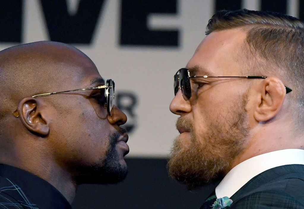 LAS VEGAS, NV - AUGUST 23: Boxer Floyd Mayweather Jr. (L) and UFC lightweight champion Conor McGregor face off during a news conference at the KA Theatre at MGM Grand Hotel & Casino on August 23, 2017 in Las Vegas, Nevada. The two will meet in a super welterweight boxing match at T-Mobile Arena on August 26 in Las Vegas. (Photo by Ethan Miller/Getty Images)