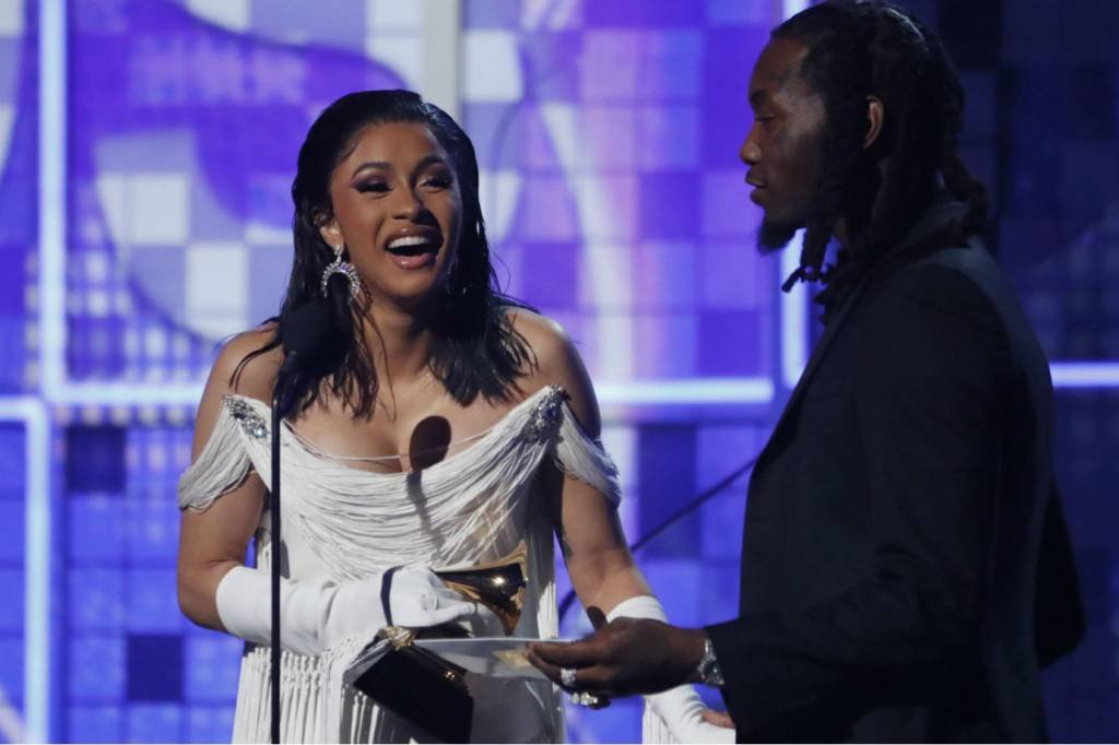 """Cardi B accepts the Best Rap Album award for """"Invasion of Privacy"""" next to her husband Offset. REUTERS/Mike Blake"""