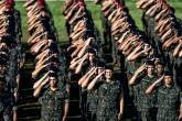 Brazilian Army soldiers stand at attention during a ceremony to mark their graduation from training on how to combat the Aedes aegypti mosquito in Rio de Janeiro