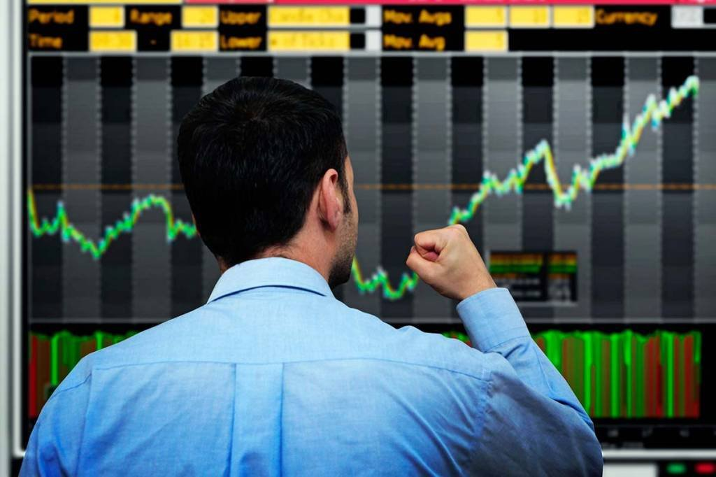 Trader e bolsa de valores em alta