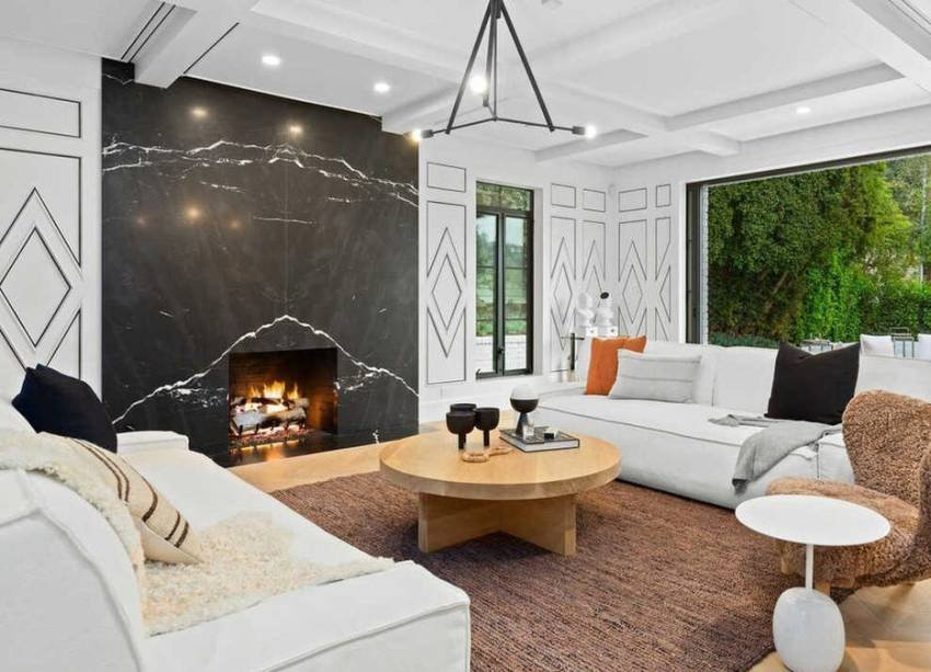 Living room with marble fireplace.