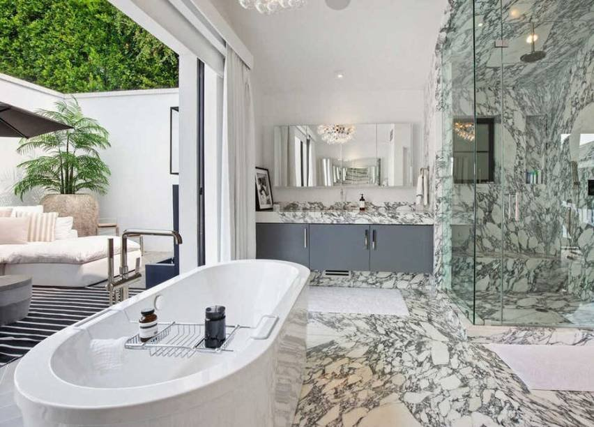 Suite with marble floors, bathtub and terrace.