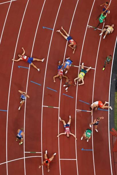TOKYO, JAPAN - AUGUST 05: Runners respond after competing in the men's 1500m decathlon on day 13 of the Tokyo 2020 Olympic Games at the Olympic Stadium on August 5, 2021 in Tokyo, Japan.  (Photo by Richard Heathcote/Getty Images)