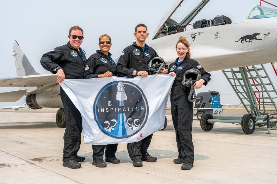 Inspiration4 crew holding mission flag