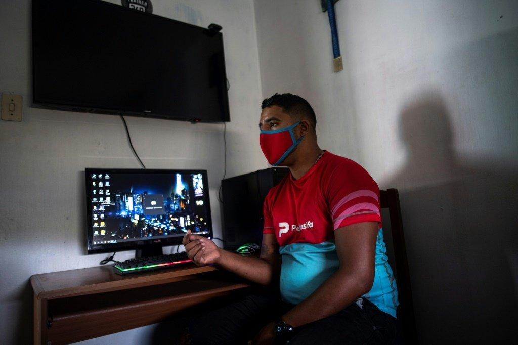 urn newsml afp.com 20210920 f2fef0a2 965c 4aee b968 3f64edd54dc9 ipad From cop to gardener online: NFT games win fans in Venezuela